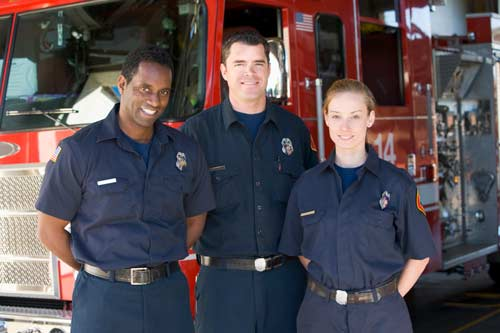 three fire fighters standing in front of fire truck
