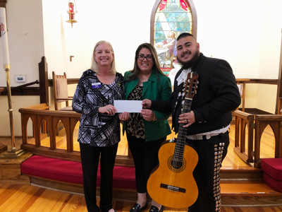 Missiong Grant check presentation with Debbie Yocky delivering check to Ysleta Mission