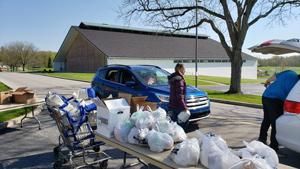 woman loading milk into van