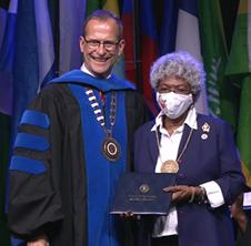 Janis receiving award