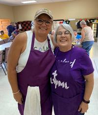 LWML ladies wearing aprons